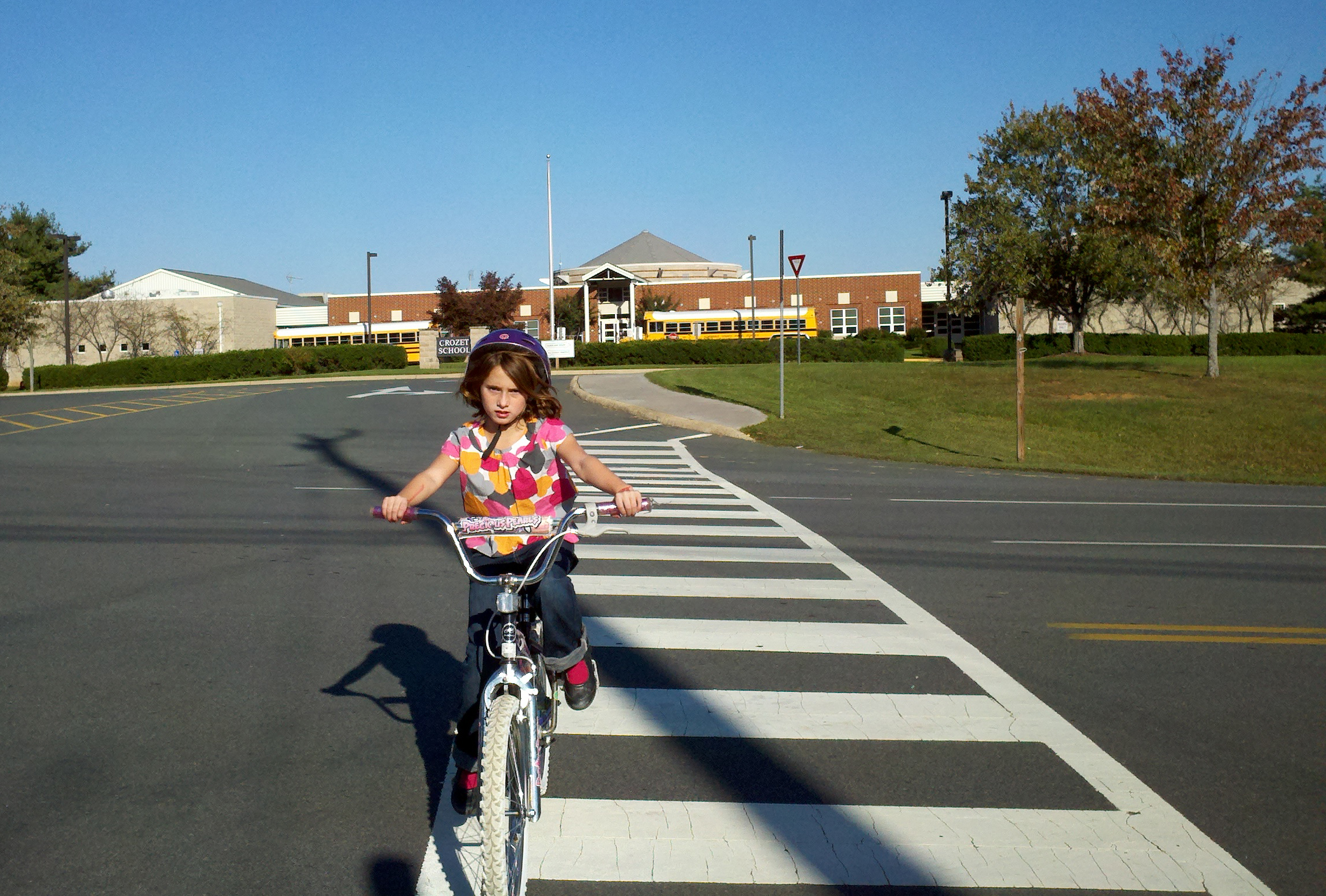 Ella Duncan regularly rides her bike home from Crozet Elementary with her father, Jim, who promotes walk-to-school initiatives on his blog, RealCrozetVA.com. Photo courtesy Jim Duncan.