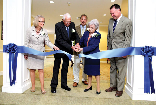 Judy Bowes, Lodge executive director; David Spicer, Lodge owner David Hilliard, Norma Wood, and State Senator Creigh Deeds