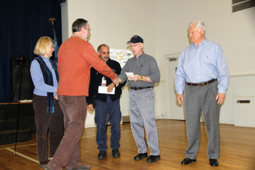 The CCA presented a check for $1,300 to the Build Crozet Library fund.