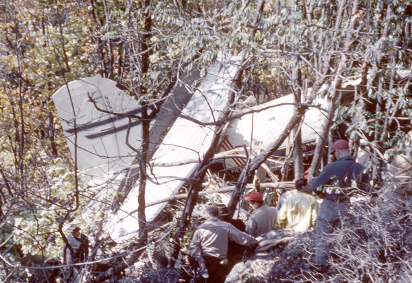 Flight 349's tail section lies beneath a displaced wing. Visible are Piedmont Airlines' distinctive blue and red colors along with the aircraft's registration #N55V. Photo by Les Gibson.