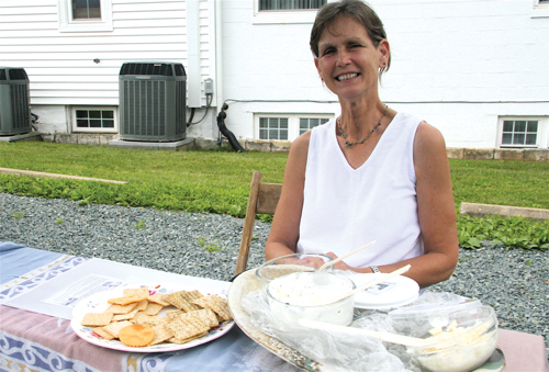 Sharon Smith and her goat cheese at the Crozet Farmers' Market.