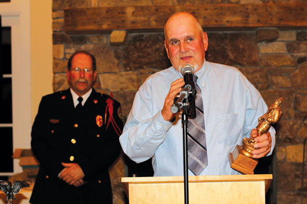 Lewis Burnette accepted the award with praise for his fellow firefighters. Behind him is CVFD president Rodney Rich.