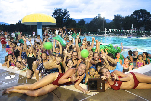 The Champs! Finally, Fairview falls.  Exuberant Crozet Gators crowd the wading pool at Claudius Crozet Park as they try to make a team picture with the 2013 Jefferson Swim League Trophy on July 27.