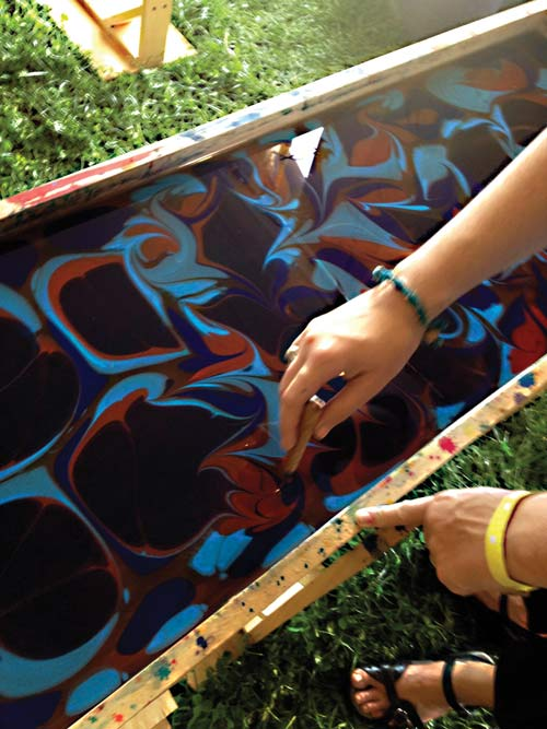 The popular silk scarf painting activity from the spring festival will be available again.
