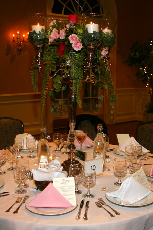With the exception of the roses, this winter wedding centerpiece was made of locally foraged materials.