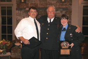 CVFD Chief Preson Gentry with Chief's Award winners Mitch Fitzgerald and Elise Linquist.