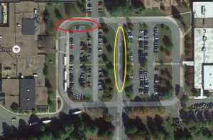 """New """"No Parking"""" are installed in the yellow area,  and """"No Parking or Standing"""" signs are in the red area."""